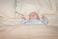 Baby sleeping in bed a a image orientation is horizontal and there is copy space Royalty Free Stock Photography