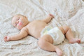 Baby is sleeping little on the parent s bed Stock Photos