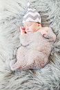Baby sleeping newborn in cocoon on soft fur Royalty Free Stock Photography