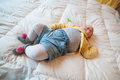 Baby sleeping on the pink bed with onesie lying supine a ligth Stock Photo