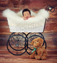 Baby sleeping a studio vintage photo of a newborn inside a carriage Royalty Free Stock Photography