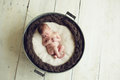 Baby sleeping in a tub newborn boy wash Royalty Free Stock Photos