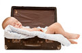 Baby sleeps in the suitcase Stock Photos