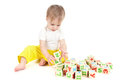 Baby the small child builds a tower of cubes Royalty Free Stock Photography