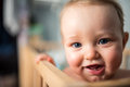 Baby smiling in his crib Royalty Free Stock Photo