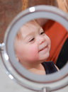 Baby smiling indoor in a mirror Royalty Free Stock Photos