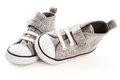 Baby sneakers white background Royalty Free Stock Photo
