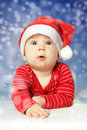 Baby on snow sky background new year Stock Image