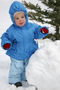 Baby with snowball Royalty Free Stock Photos