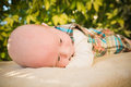 Baby snuggling for a nap cute enjoying the wonders of the outside world image orientation is horizontal and there is copy space Royalty Free Stock Photo