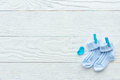 Baby socks at wooden background Royalty Free Stock Photo