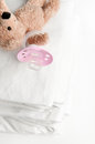 Baby soother and laundry Royalty Free Stock Photo