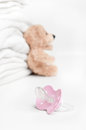 Baby soother and teddy Royalty Free Stock Photo