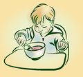 The baby with a spoon in hand eats. Royalty Free Stock Photo