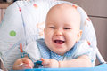 Baby with spoon smiling newborn Royalty Free Stock Photo