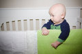 Baby standing in crib a his Royalty Free Stock Images