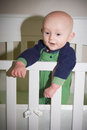 Baby standing in crib a his Royalty Free Stock Photo
