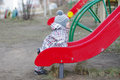 Baby standing by slide on playground age of year Royalty Free Stock Images