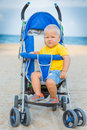 Baby in stroller adorable sitting Stock Images