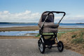 Baby stroller on beach Royalty Free Stock Photo