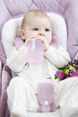Baby in a stroller with bottle laying down Stock Photo