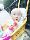 Baby in stroller hold mic toy lovely boy phone Stock Image