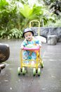 Baby in stroller sweet boy look at flowers Royalty Free Stock Photos