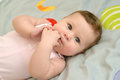 The baby sucks fingers in a mouth. Portrait Royalty Free Stock Photo