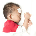 Baby suffering fever heat sleeping and Royalty Free Stock Image
