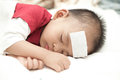 Baby suffering fever heat sleeping and Royalty Free Stock Photography