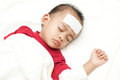 Baby suffering fever heat sleeping and Royalty Free Stock Photo