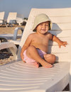 Baby on sun lounger cute sitting Stock Images