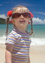 Baby  in sunglasses at sea coast. Royalty Free Stock Images