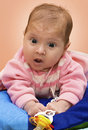 Baby surprised face lying on the pillow surprise Stock Photo