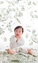 Baby surprised funny face with money rain Royalty Free Stock Photo