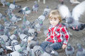 Baby Surrounded by Doves Stock Photography