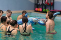 Baby swimming lessons poznan poland january group of parents with their babies having Royalty Free Stock Image