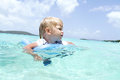 Baby swimming in tropical ocean child a caribbean summer vacation Stock Image