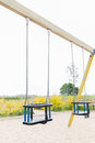 Baby swing on playground outdoors Royalty Free Stock Photo