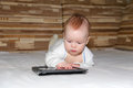 Baby and tablet computer exploring new Royalty Free Stock Image