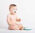 Baby Talking with Cake Frosting on His Face Royalty Free Stock Photo