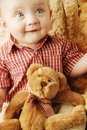 Baby With A Teddy Bear Stock Photo