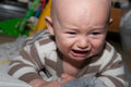 Baby temper tantrum with blue eyes crying and angry Royalty Free Stock Photos
