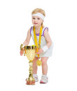 Baby in tennis clothes holding medal and goblet happy Stock Images