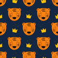 Baby tiger with gold crown seamless pattern on dark blue background. Royalty Free Stock Photo