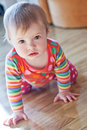 Baby to crawl on the floor and with interest looking at camera Stock Photos