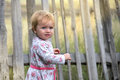 Baby toddler at the fence Royalty Free Stock Photo