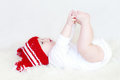 Baby touches his foots the Royalty Free Stock Photography