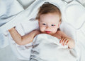 Baby with a towel one year old in bed after taking bath Royalty Free Stock Image