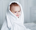 Baby with a towel one year old in bed after taking bath Stock Photos